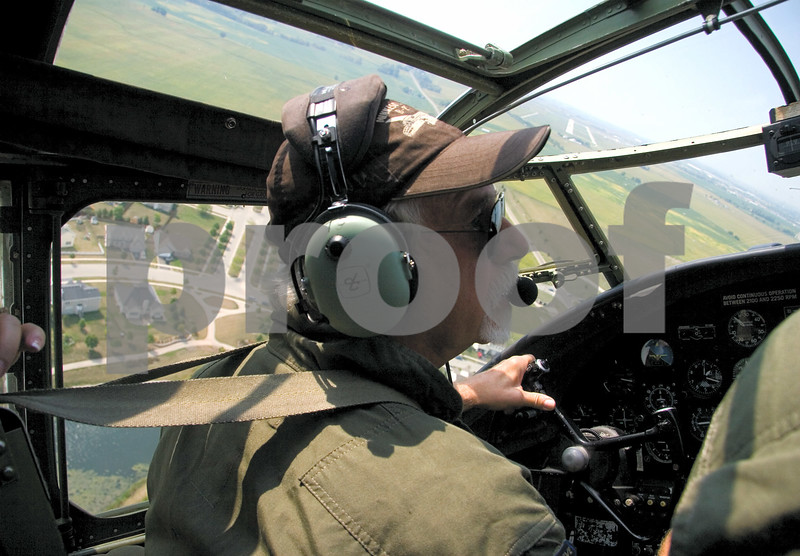 """Curtis Clegg - cclegg@shawmedia.com<br /> <br /> Terrel Stern, co-pilot of the World War II-era B-25  bomber """"Miss Mitchell"""" in the cockpit of the plane as it banks left to make its final approach to DeKalb Taylor Municipal Airport on Friday, August 24, 2012. The B-25 will be part of the air fest at the airport during Corn Fest through Sunday afternoon."""