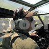 "Curtis Clegg - cclegg@shawmedia.com<br /> <br /> Terrel Stern, co-pilot of the World War II-era B-25  bomber ""Miss Mitchell"" in the cockpit of the plane as it banks left to make its final approach to DeKalb Taylor Municipal Airport on Friday, August 24, 2012. The B-25 will be part of the air fest at the airport during Corn Fest through Sunday afternoon."