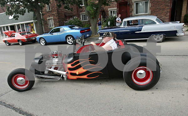 Rob Winner – rwinner@shawmedia.com<br /> <br /> Genoa resident Steve Hayes pulls into a parking lot with a 1927 Ford Roadster during the Turning Back Time Weekend Cruise Night in Sycamore, Ill., Saturday, July 28, 2012.