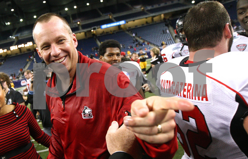 Kyle Bursaw – kbursaw@shawmedia.com<br /> <br /> Northern Illinois head coach Dave Doeren is all smiles as he points to one of his assistant coaches after the Huskies 44-37 overtime victory over Kent State in the MAC conference championship game at Ford Field in Detroit, Mich. on Friday, Nov. 30, 2012.