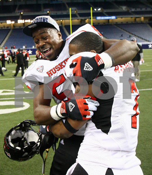 Kyle Bursaw – kbursaw@shawmedia.com<br /> <br /> Northern Illinois defensive end Daniel Green (56) embraces wide receiver Perez Ashford (7) after the Huskies 44-37 overtime victory over Kent State in the MAC conference championship game at Ford Field in Detroit, Mich. on Friday, Nov. 30, 2012.