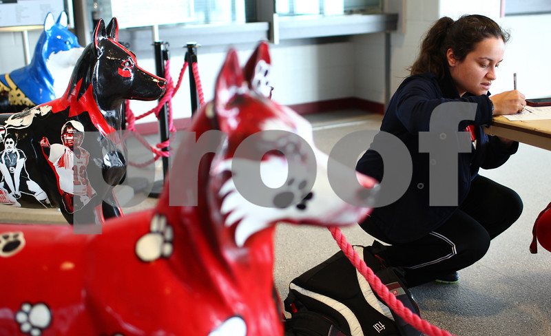 Kyle Bursaw – kbursaw@shawmedia.com<br /> <br /> Jocelyn LaBoy, an NIU student, fills out the order form for a ticket to the Discover Orange Bowl at the Convocation Center on Monday, Dec. 3, 2012.