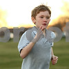 Kyle Bursaw – kbursaw@shawmedia.com<br /> <br /> Sycamore resident Alex Taylor, 9, runs a mile at race pace during practice for Northern Illinois Athletics, a youth development cross country program at Sycamore Community Park on Tuesday, Dec. 4, 2012.