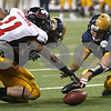 Kyle Bursaw – kbursaw@shawmedia.com<br /> <br /> Northern Illinois cornerback Rashaan Melvin (11) and Kent State quarterback Spencer Keith reach for a fumble in the first overtime period. Kent State recovered the fumble. The Northern Illinois University Huskies defeated the Kent State Golden Flashes 44-37 in the MAC conference championship game at Ford Field in Detroit, Mich. on Friday, Nov. 30, 2012.