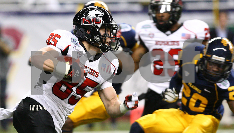 Kyle Bursaw – kbursaw@shawmedia.com<br /> <br /> Northern Illinois wide receiver A.J. Sebastiano (85) returns a punt in the second quarter. The Northern Illinois University Huskies defeated the Kent State Golden Flashes 44-37 in the MAC conference championship game at Ford Field in Detroit, Mich. on Friday, Nov. 30, 2012.