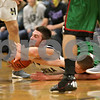 Rob Winner – rwinner@shawmedia.com<br /> <br /> Hiawatha's Dakotah Quimby (left) and Earlville-Leland's Andrew Walsh struggle for a ball during the second quarter in Kirkland, Ill., Friday, Dec. 7, 2012. Hiawatha defeated Earlville-Leland, 44-43.