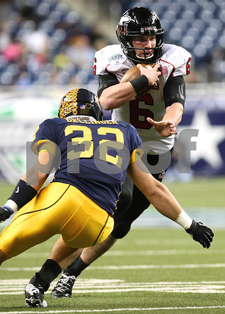 Kyle Bursaw – kbursaw@shawmedia.com<br /> <br /> Northern Illinois quarterback Jordan Lynch (6) takes off with the ball as Kent State linebacker Matt Dellinger closes in on him in the second quarter. The Northern Illinois University Huskies defeated the Kent State Golden Flashes 44-37 in the MAC conference championship game at Ford Field in Detroit, Mich. on Friday, Nov. 30, 2012.