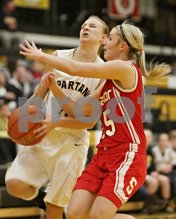 Rob Winner – rwinner@shawmedia.com<br /> <br /> Sycamore's Paige Wogen (left) goes to the basket while Streator's Madison Hall defends in the first quarter in Sycamore, Ill., Tuesday, Dec. 4, 2012. Hall was not called for a foul on the play.