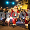 Rob Winner – rwinner@shawmedia.com<br /> <br /> Santa Claus and his many followers march east from the Midwest Museum of Natural History to the DeKalb County Courthouse on State Street in downtown Sycamore, Ill., Friday, Dec. 7, 2012.