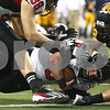 Kyle Bursaw – kbursaw@shawmedia.com<br /> <br /> Northern Illinois quarterback Jordan Lynch (6) is brought down one yard short by Kent State safety Luke Wollet in the second quarter, setting up a touchdown by running back Akeem Daniels (3). The Northern Illinois University Huskies defeated the Kent State Golden Flashes 44-37 in the MAC conference championship game at Ford Field in Detroit, Mich. on Friday, Nov. 30, 2012.