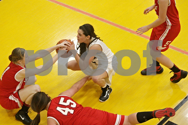 Rob Winner – rwinner@shawmedia.com<br /> <br /> Sycamore's Jenee Carlson (center) steals the ball from Streator's Shawna Meiners (45) in the second quarter in Sycamore, Ill., Tuesday, Dec. 4, 2012.