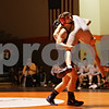Rob Winner – rwinner@shawmedia.com<br /> <br /> DeKalb's Matt Macarus (left) lifts Kaneland's Austin Parks during their 152-pound match in DeKalb, Ill., Thursday, Dec. 6, 2012. DeKalb defeated Kaneland, 50-23.