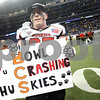 Kyle Bursaw – kbursaw@shawmedia.com<br /> <br /> With hopes of being in a BCS bowl game still alive after NIU's 44-37 victory over Kent State, Northern Illinois linebacker Bobby Winkel (27) holds a sign from one of the fans at Ford Field in Detroit, Mich. on Friday, Nov. 30, 2012.