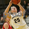 Rob Winner – rwinner@shawmedia.com<br /> <br /> After being fouled from behind by Streator's Morgan Sharisky, Sycamore's Bailey Gilbert (25) attempts a shot in the second quarter in Sycamore, Ill., Tuesday, Dec. 4, 2012.