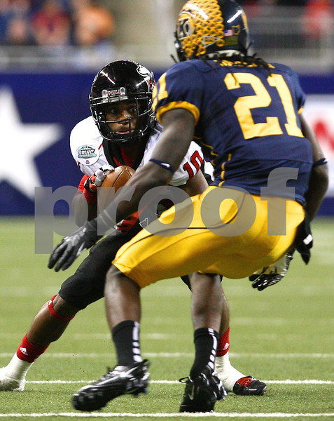 Kyle Bursaw – kbursaw@shawmedia.com<br /> <br /> Northern Illinois wide receiver Tommylee Lewis (10) makes a move to try and get around Kent State defensive back Sidney Saulter in the second quarter. The Northern Illinois University Huskies defeated the Kent State Golden Flashes 44-37 in the MAC conference championship game at Ford Field in Detroit, Mich. on Friday, Nov. 30, 2012.