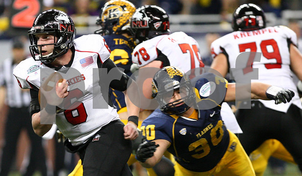 Kyle Bursaw – kbursaw@shawmedia.com<br /> <br /> Northern Illinois quarterback Jordan Lynch (6) runs upfield, evading Kent State linebacker Luke Batton (30) in the fourth quarter. The Northern Illinois University Huskies defeated the Kent State Golden Flashes 44-37 in the MAC conference championship game at Ford Field in Detroit, Mich. on Friday, Nov. 30, 2012.