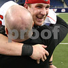 Kyle Bursaw – kbursaw@shawmedia.com<br /> <br /> Northern Illinois University employee Joe Summins hugs quarterback Jordan Lynch (6) lifting him off the ground after the Huskies 44-37 overtime victory over Kent State in the MAC conference championship game at Ford Field in Detroit, Mich. on Friday, Nov. 30, 2012.