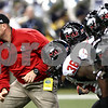Kyle Bursaw – kbursaw@shawmedia.com<br /> <br /> Northern Illinois head coach Dave Doeren takes the field with his players before the MAC conference championship game at Ford Field in Detroit, Mich. on Friday, Nov. 30, 2012.