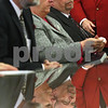Kyle Bursaw – kbursaw@shawmedia.com<br /> <br /> DeKalb County Coroner Dennis Miller (left) and new DeKalb County State's Attorney Richard Schmack (right) wait for their turns to be sworn in to office in the DeKalb County Courthouse on Monday, Dec. 3, 2012. Schmack's wife Jackie (center) sits with him.