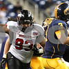 Kyle Bursaw – kbursaw@shawmedia.com<br /> <br /> Northern Illinois defensive tackle Ken Bishop (93) closes in to sack Kent State quarterback Spencer Keith (3) in the second quarter. The Northern Illinois University Huskies defeated the Kent State Golden Flashes 44-37 in the MAC conference championship game at Ford Field in Detroit, Mich. on Friday, Nov. 30, 2012.