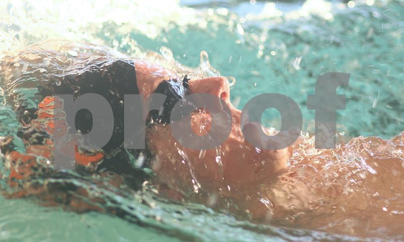 Kyle Bursaw – kbursaw@shawmedia.com<br /> <br /> Marc Dubrick swims backstroke at DeKalb/Sycamore coop practice on Wednesday, Nov. 28, 2012.