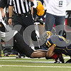 Kyle Bursaw – kbursaw@shawmedia.com<br /> <br /> Northern Illinois wide receiver Martel Moore (1) stretches for more yards as he is brought down by Kent State defensive back Norman Wolfe Jr. in the first quarter. The Northern Illinois University Huskies defeated the Kent State Golden Flashes 44-37 in the MAC conference championship game at Ford Field in Detroit, Mich. on Friday, Nov. 30, 2012.