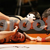 Rob Winner – rwinner@shawmedia.com<br /> <br /> DeKalb's Jackson Montgomery (top) attempts to pin Kaneland's David Barnhart during their 126-pound match in DeKalb, Ill., Thursday, Dec. 6, 2012. DeKalb defeated Kaneland, 50-23.