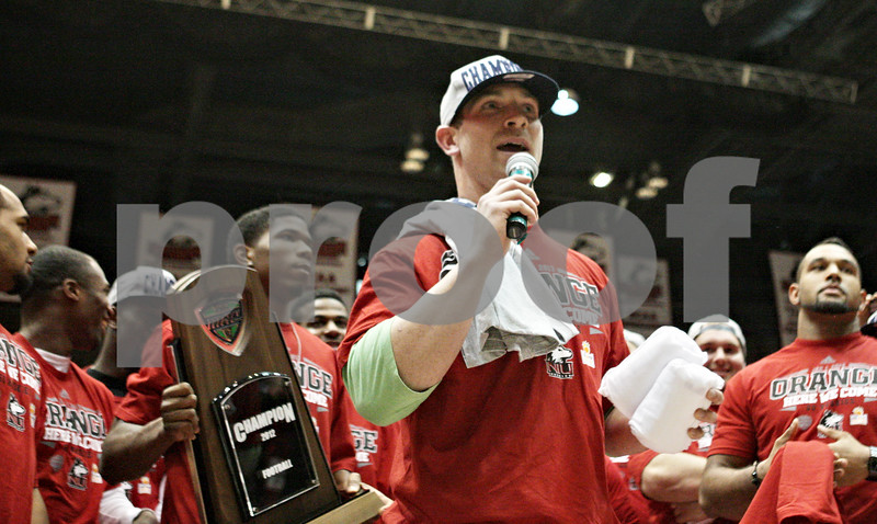 Rob Winner – rwinner@shawmedia.com<br /> <br /> Northern Illinois quarterback Jordan Lynch speaks at a pep rally for the NIU football team during halftime of the men's basketball game at the Convocation Center in DeKalb, Ill., Wednesday, Dec. 5, 2012.