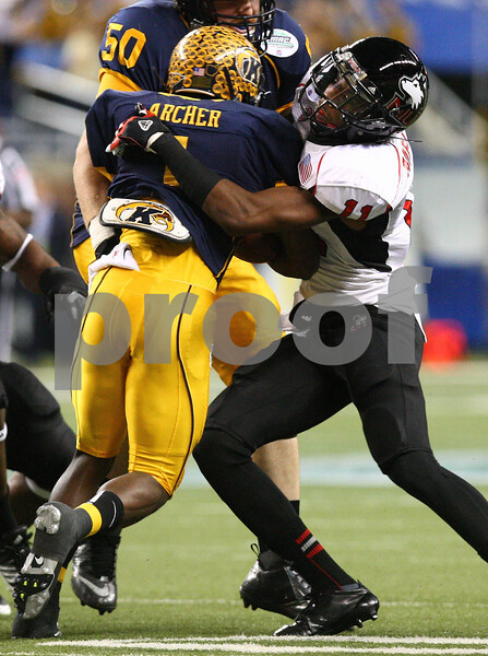 Kyle Bursaw – kbursaw@shawmedia.com<br /> <br /> Northern Illinois cornerback Rashaan Melvin (11) wraps up Kent State running back Dri Archer in the first quarter. The Northern Illinois University Huskies defeated the Kent State Golden Flashes 44-37 in the MAC conference championship game at Ford Field in Detroit, Mich. on Friday, Nov. 30, 2012.