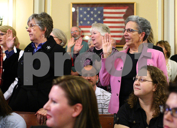 Kyle Bursaw – kbursaw@shawmedia.com<br /> <br /> DeKalb County Circuit Clerk Maureen  Josh (not pictured) swears in members of her office including Marilyn Stromborg (right) in the DeKalb County Courthouse on Monday, Dec. 3, 2012.
