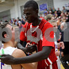 Kyle Bursaw – kbursaw@shawmedia.com<br /> <br /> Hinckley-Big Rock's Bernie Conley embraces Moosheart's Mangisto Deng following Hinckley-Big Rock's 58-51 victory over Mooseheart at Hinckley-Big Rock High School on Wednesday, Dec. 5, 2012.