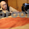 Kyle Bursaw – kbursaw@shawmedia.com<br /> <br /> Ivan Prall, 90, reminisces about his time as an Army photographer in World War II after showing off a few of the items he's held onto over the years including his camera, a Japanese flag carried by one of their soldiers and his carbine rifle in his Malta home on Thursday, Dec. 6, 2012.