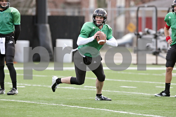 Rob Winner – rwinner@shawmedia.com<br /> <br /> Northern Illinois quarterback Jordan Lynch looks to pass during practice at Huskie Stadium in DeKalb, Ill., Saturday, Dec. 8, 2012.