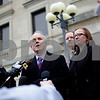 Kyle Bursaw – kbursaw@shawmedia.com<br /> <br /> Former DeKalb County State's Attorney Clay Campbell takes questions from the media as Julie Trevarthen (right), who was one of the prosecutors on the case stands behind Campbell outside the DeKalb County Courthouse following the sentencing of Jack McCullough on Monday, Dec. 10, 2012.