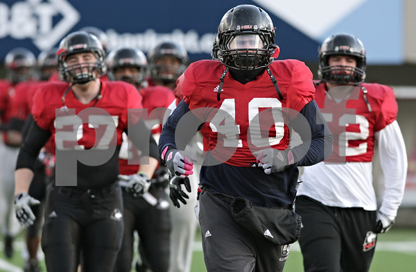 Rob Winner – rwinner@shawmedia.com<br /> <br /> Northern Illinois linebacker Victor Jacques runs a drill during practice at Huskie Stadium in DeKalb, Ill., Saturday, Dec. 8, 2012.