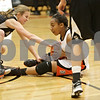 Rob Winner – rwinner@shawmedia.com<br /> <br /> Kaneland's Vanessa Gould (left) reaches for a ball controlled by DeKalb's Courtney Patrick during the second quarter in DeKalb, Ill., Tuesday, Dec. 11, 2012. DeKalb defeated Kaneland, 31-17.