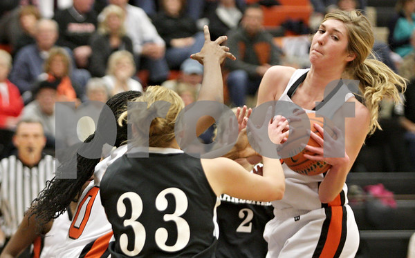 Rob Winner – rwinner@shawmedia.com<br /> <br /> DeKalb's Courtney Bemis (right) controls an offensive rebound during the second quarter in DeKalb, Ill., Tuesday, Dec. 11, 2012. DeKalb defeated Kaneland, 31-17.