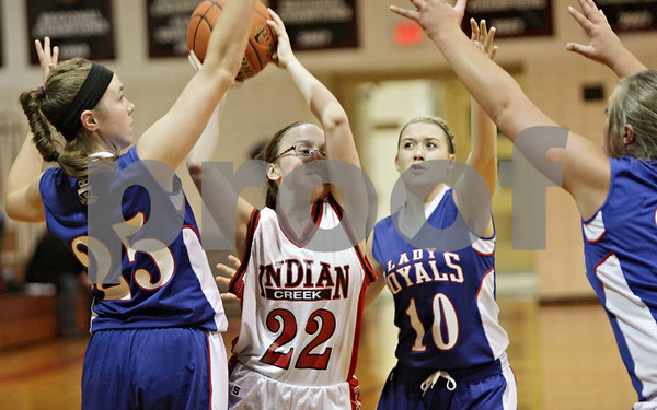 Rob Winner – rwinner@shawmedia.com<br /> <br /> Indian Creek's Kirsten Herrmann (22) tries to pass while a trio of Hinckley-Big Rock defenders look for a turnover during the first quarter in Shabbona, Ill., Thursday, Dec. 13, 2012. H-BR defeated Indian Creek, 48-31.