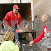 Rob Winner – rwinner@shawmedia.com<br /> <br /> Steven Scoughton receives donated toys from Chelsea Born (left), 8, and her grandmother Nancy Rohler (right) during a Toys for Tots drive outside the Walmart Supercenter in DeKalb, Ill., Saturday, Dec. 8, 2012.