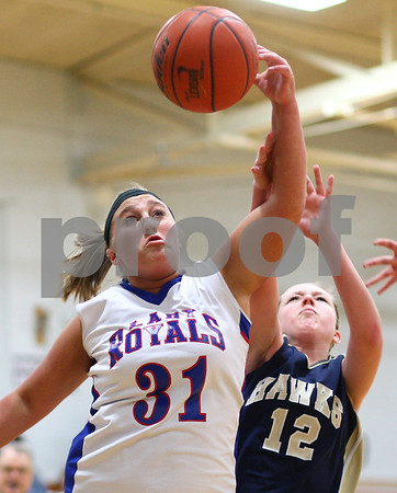 Kyle Bursaw – kbursaw@shawmedia.com<br /> <br /> Hinckley-Big Rock's Bridgette Edmeier pulls down a rebound over Hiawatha's Alanna Sterling beneath the Hawk's basket in the first quarter at Hinckley-Big Rock on Monday, Dec. 10, 2012. Hinckley defeated Hiawatha  63-18.