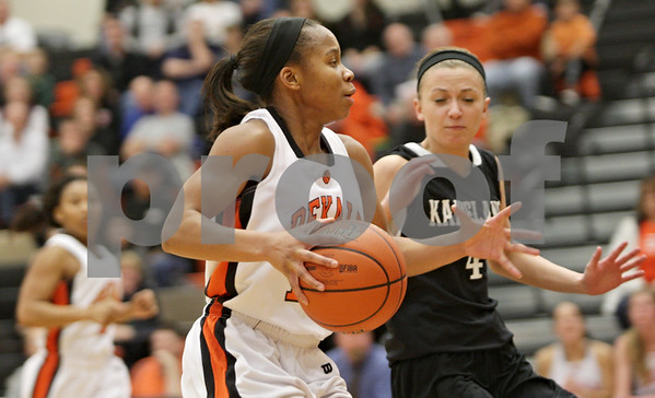 Rob Winner – rwinner@shawmedia.com<br /> <br /> After a steal, DeKalb's Brittney Patrick (front) goes to the basket for two and draws the foul from Kaneland's Caroline Heimerdinger (right) during the third quarter in DeKalb, Ill., Tuesday, Dec. 11, 2012. Patrick was successful on the free throw attempt for a 3-point play. DeKalb defeated Kaneland, 31-17.