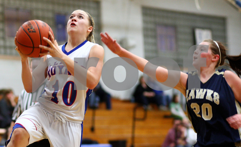 Kyle Bursaw – kbursaw@shawmedia.com<br /> <br /> Hinckley-Big Rock's Jacqueline Madden goes for a layup in front of Hiawatha's Madison Marshall in the second quarter of the game at Hinckley-Big Rock on Monday, Dec. 10, 2012. Hinckley defeated Hiawatha  63-18.