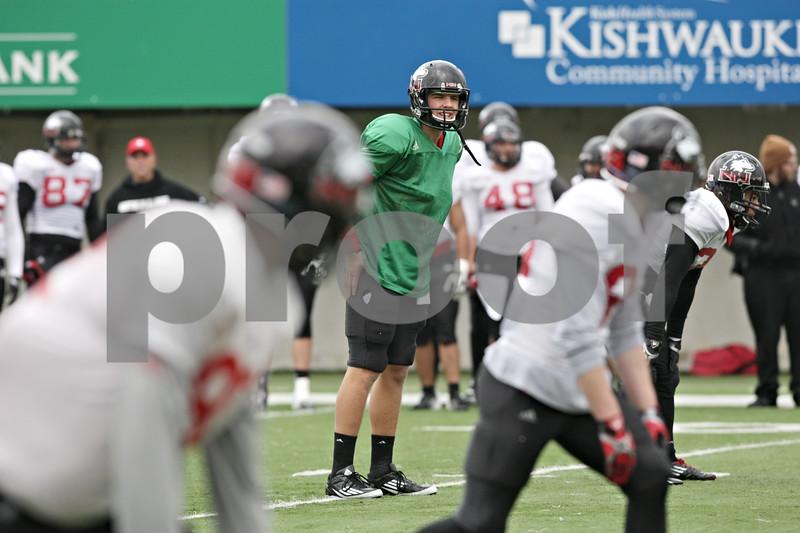 Rob Winner – rwinner@shawmedia.com<br /> <br /> Northern Illinois quarterback Matt Williams participates in a drill during practice at Huskie Stadium in DeKalb, Ill., Saturday, Dec. 8, 2012.