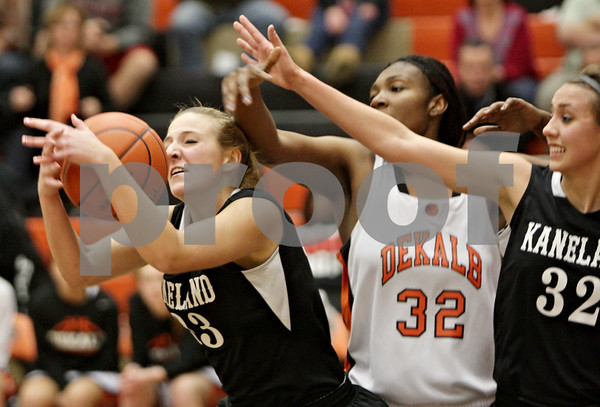 Rob Winner – rwinner@shawmedia.com<br /> <br /> Kaneland's Marina Schaefer (left) controls a rebound under the DeKalb basket during the third quarter in DeKalb, Ill., Tuesday, Dec. 11, 2012. DeKalb defeated Kaneland, 31-17.