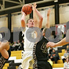 Rob Winner – rwinner@shawmedia.com<br /> <br /> Sycamore's Ben Niemann (20) puts up a shot during the first quarter in a game against Kaneland in Sycamore, Ill., Saturday, Dec. 8, 2012.