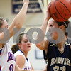 Kyle Bursaw – kbursaw@shawmedia.com<br /> <br /> Hiawatha's Dani Clark sets up to shoot while being defended by Andrea Binkley in the first quarter of the game at Hinckley-Big Rock on Monday, Dec. 10, 2012. Hinckley defeated Hiawatha  63-18.