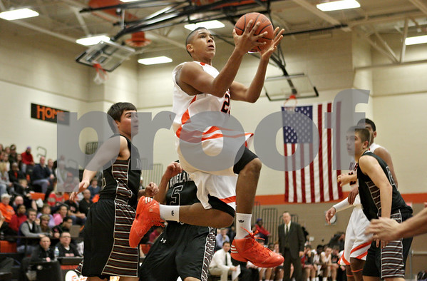 Rob Winner – rwinner@shawmedia.com<br /> <br /> DeKalb's Rudy Lopez goes to the basket for two during the second quarter in DeKalb, Ill., Friday, Dec. 14, 2012. Kaneland defeated DeKalb, 50-45.