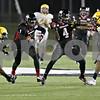 Rob Winner – rwinner@shawmedia.com<br /> <br /> Toledo cornerback Chris Dukes (5) gets a hand on Northern Illinois receiver Martel Moore (1) as Da'Ron Brown (4) blocks Jermaine Robinson (right) during the third quarter in DeKalb, Ill., Wednesday, Nov. 14, 2012.