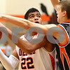 Kyle Bursaw – kbursaw@shawmedia.com<br /> <br /> DeKalb's Andre Harris looks for a shot while being defended by Winnebago guard Matt Reinke in the first quarter of their game in the Chuck Dayton Holiday Tournament in DeKalb, Ill. on Friday, Dec. 21, 2012.