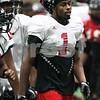 Kyle Bursaw – kbursaw@shawmedia.com<br /> <br /> Northern Illinois wide receiver Martel Moore (1) puts his helmet up during a short break at practice at the DeKalb Recreation Center on Wednesday, Dec. 19, 2012.
